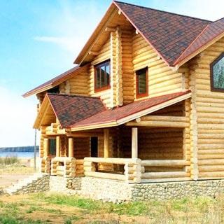 Новый жилой дом 252м на 50 сотках ИЖС в Луговом (Выборгский) продается. Фасад дома, за домом - выход к берегу Залива